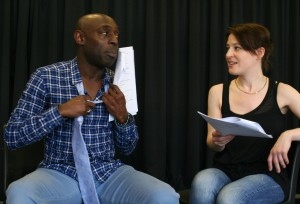 Actors workshopping a script